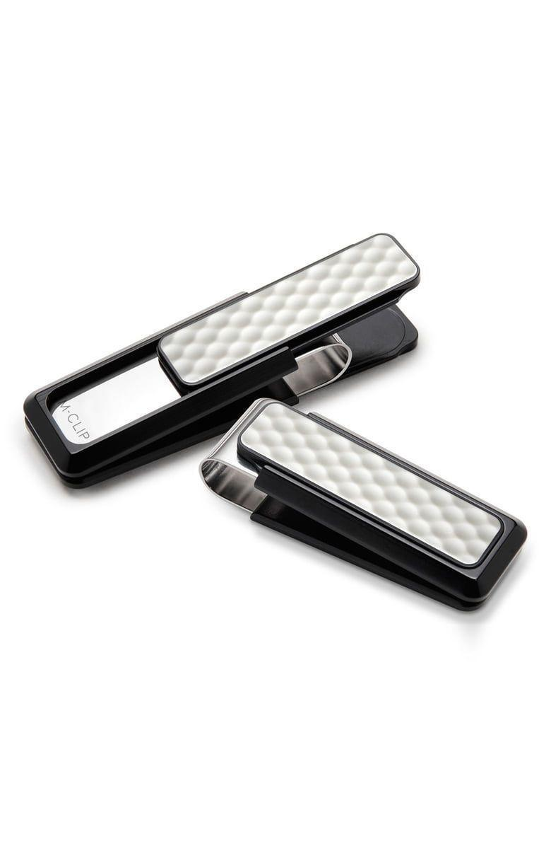 """<p><strong>M-Clip</strong></p><p>amazon.com</p><p><strong>$79.95</strong></p><p><a href=""""http://www.amazon.com/dp/B00IRG5WMK/?tag=syn-yahoo-20&ascsubtag=%5Bartid%7C10055.g.20685099%5Bsrc%7Cyahoo-us"""" rel=""""nofollow noopener"""" target=""""_blank"""" data-ylk=""""slk:Shop Now"""" class=""""link rapid-noclick-resp"""">Shop Now</a></p><p>Bulky wallets can get in the way when he's moving around the course a lot. These super sleek money clips with a golf-ball inlay might be a more fitting alternative.</p>"""