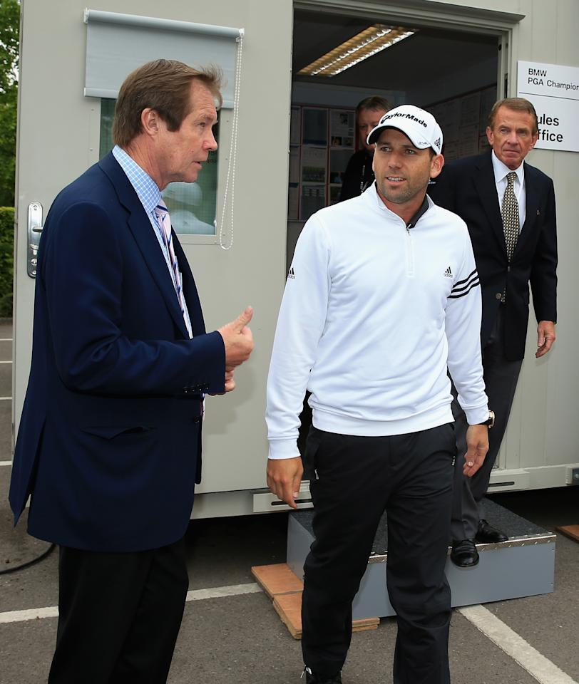 VIRGINIA WATER, ENGLAND - MAY 22:  Sergio Garcia of Spain emerges from a meeting in the rules office with George O'Grady, Chief Executive of the European Tour (L) and Tim Finchem, PGA Tour Commissioner (R) during the Pro-Am round prior to the BMW PGA Championship on the West Course at Wentworth on May 22, 2013 in Virginia Water, England.  (Photo by Richard Heathcote/Getty Images)