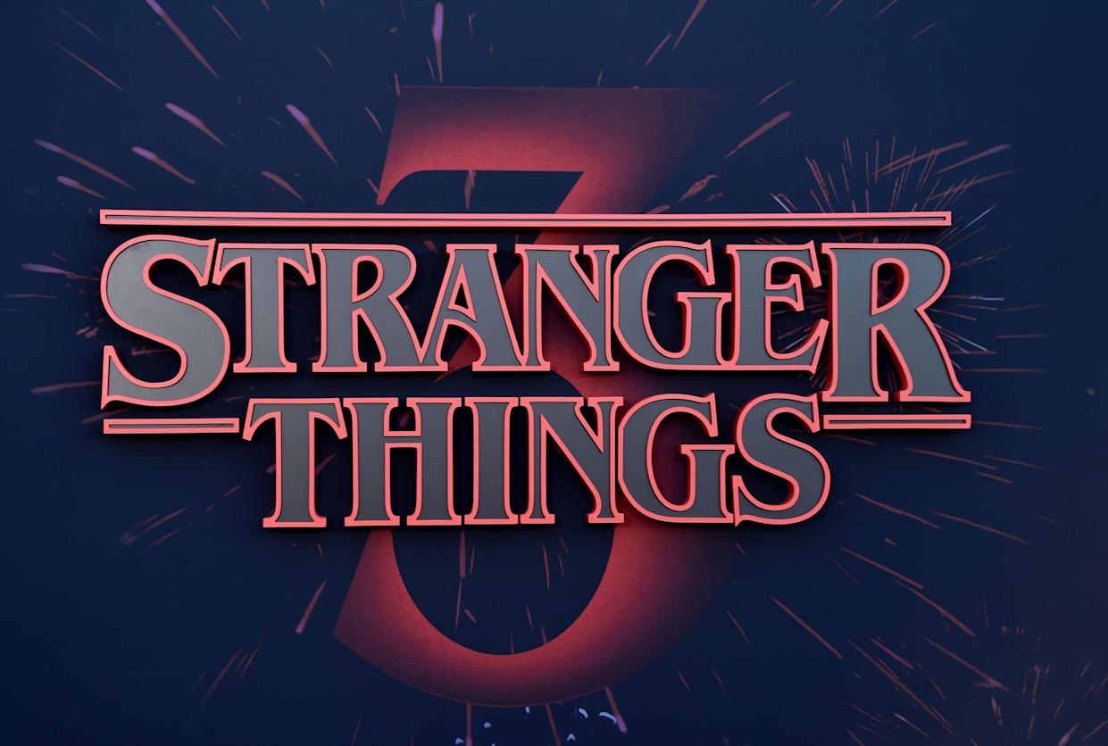 """Stranger Things logo seen on the backdrop of Netflix's """"Stranger Things 3"""" premiere at Santa Monica high school Barnum Hall on June 28, 2019 in Santa Monica, California. (Photo by Chris Delmas / AFP) (Photo credit should read CHRIS DELMAS/AFP/Getty Images)"""