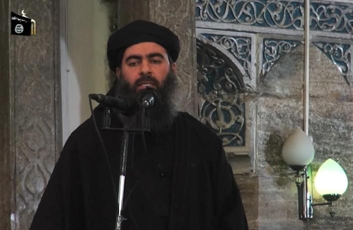 Islamic State group leader Abu Bakr al-Baghdadi is shown addressing worshippers in the militant-held Iraqi city of Mosul in this grab from a video by jihadist Al-Furqan Media on July 5, 2014 (AFP Photo/)