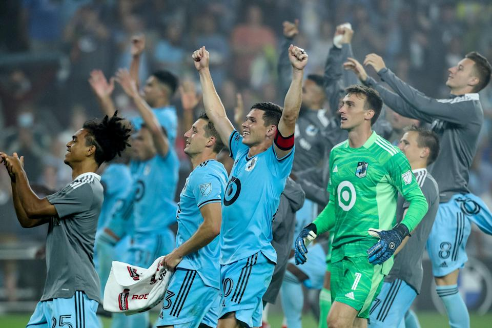 Minnesota United players celebrate after defeating the Houston Dynamo at Allianz Field on Aug. 7.