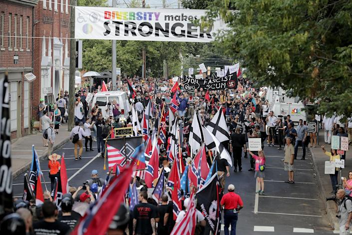 """<p>Hundreds of white nationalists, neo-Nazis and members of the """"alt-right"""" march down East Market Street toward Lee Park during the """"Unite the Right"""" rally Aug.12, 2017 in Charlottesville, Va. (Photo: Chip Somodevilla/Getty Images) </p>"""