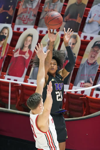 Washington guard RaeQuan Battle (21) shoots as Utah guard Pelle Larsson (3) defends during the first half of an NCAA college basketball game Thursday, Dec. 3, 2020, in Salt Lake City. (AP Photo/Rick Bowmer)