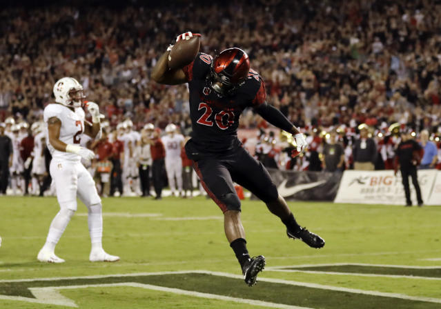"San Diego State's Rashaad Penny has emerged from <a class=""link rapid-noclick-resp"" href=""/nfl/players/30245/"" data-ylk=""slk:Donnel Pumphrey"">Donnel Pumphrey</a>'s shadow to lead the nation in rushing. (AP)"