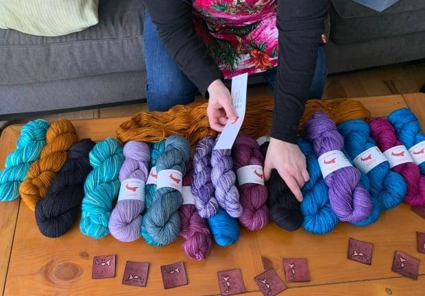 Moore labels skeins of yarn destined for retail stores and her own website.