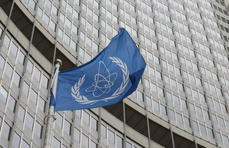 The flag of the IAEA flies in front of its headquarters in Vienna