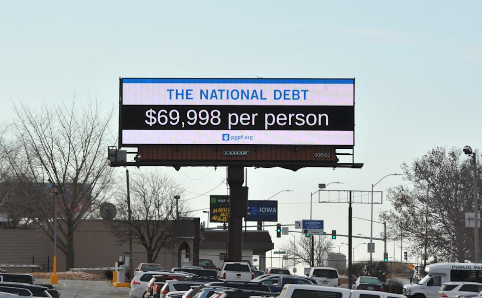 DES MOINES, IA - DECEMBER 18: A Peterson Foundation billboard displaying the national debt is pictured along Fleur Drive on December 18, 2019 in Des Moines, Iowa. (Photo by Steven Pope/Getty Images for PGPF)