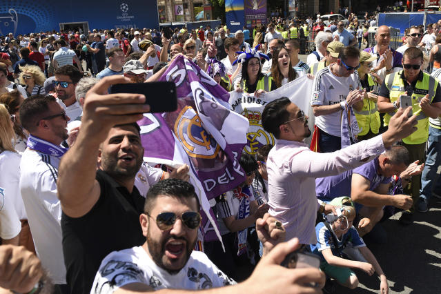 Real Madrid supporters react as they take selfies in Kiev, Ukraine, Saturday, May 26, 2018. Supporters were gathering in Kiev ahead of the Champions League final soccer match between Real Madrid and Liverpool later Saturday. (AP Photo/Andrew Shevchenko)