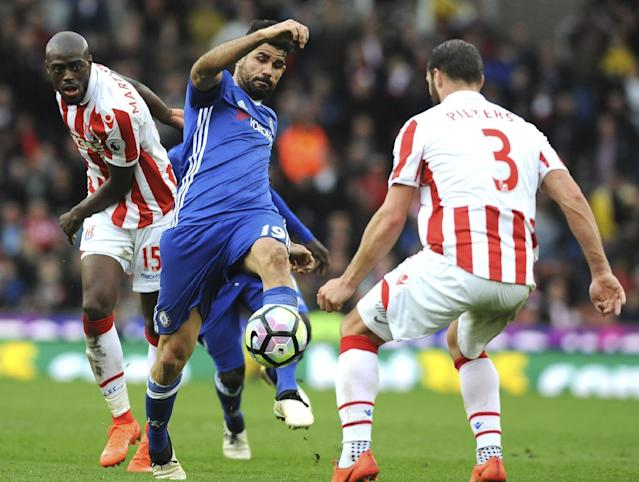 <p>Chelsea's Diego Costa, centre, battles for the ball with Stoke's Bruno Martins Indi, left, and Erik Pieters during the English Premier League soccer match between Stoke City and Chelsea at the Britannia Stadium, Stoke on Trent, England, Saturday, March 18, 2017. (AP Photo/Rui Vieira) </p>