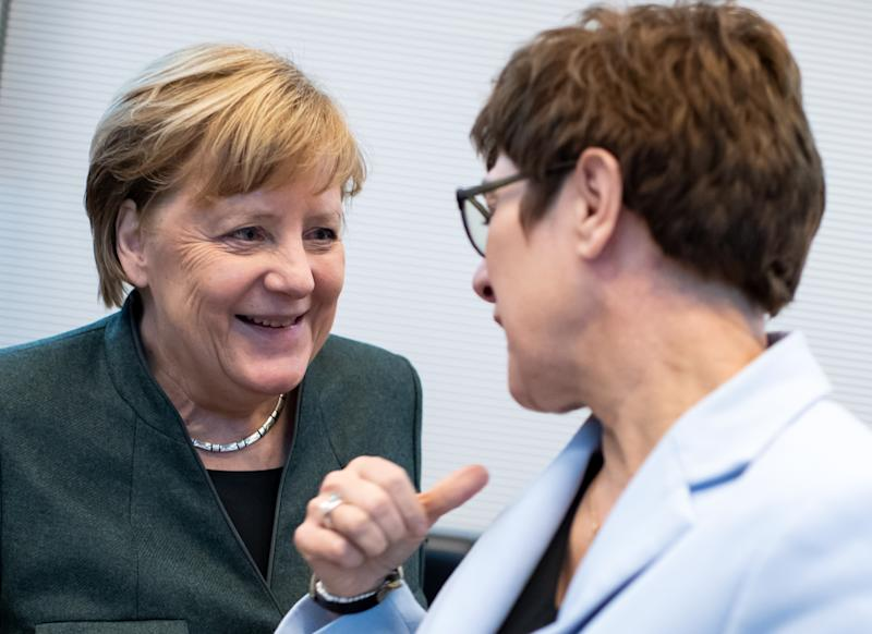 11 February 2020, Berlin: German Chancellor Angela Merkel (l, CDU) and Annegret Kramp-Karrenbauer (CDU), Minister of Defence and CDU Federal Chairwoman, talk at the beginning of the session of the CDU/CSU parliamentary group in the German Bundestag. Photo: Bernd von Jutrczenka/dpa (Photo by Bernd von Jutrczenka/picture alliance via Getty Images)