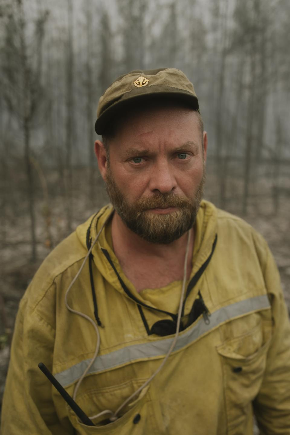 """Denis Markov, an instructor at a base for paratrooper firefighters from Tomsk speaks during his interview fro the Associated Press at Gorny Ulus area west of Yakutsk, Russia, Friday, July 23, 2021. """"Volunteers are doing a great job. Their help is significant because the area and distances are quite large, so the more people there are, the more effective our efforts are to control the fires,"""" said Dennis Markov. The hardest hit area is the Sakha Republic, also known as Yakutia, in the far northeast of Russia, about 5,000 kilometers (3,200 miles) from Moscow. (AP Photo/Ivan Nikiforov)"""