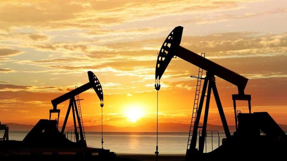 Oil pumps against sunset
