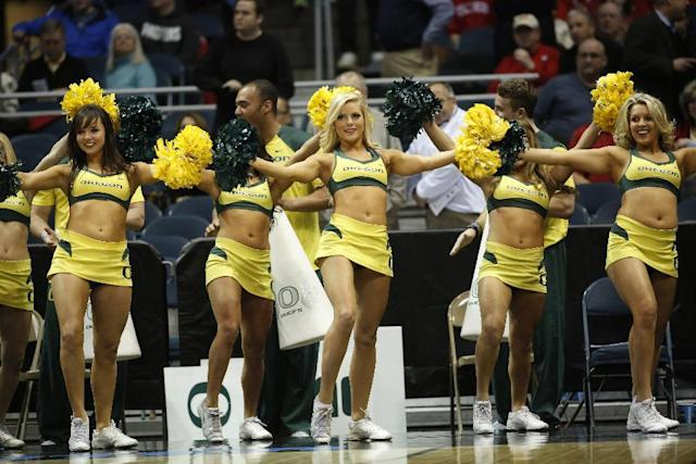 Oregon cheerleaders perform during the first half of a second-round game against the BYU in the NCAA college basketball tournament Thursday, March 20, 2014, in Milwaukee. (AP Photo/Jeffrey Phelps)
