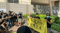 Supporters of Hong Kong's Apple Daily gather outside court