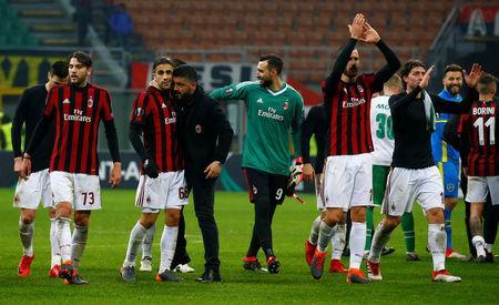 FILE PHOTO - Soccer Football - Europa League Round of 32 Second Leg - AC Milan vs PFC Ludogorets Razgrad - San Siro, Milan, Italy - February 22, 2018 AC Milan coach Gennaro Gattuso celebrates with Ricardo Rodriguez as Leonardo Bonucci applauds the fans at the end of the match. REUTERS/Tony Gentile
