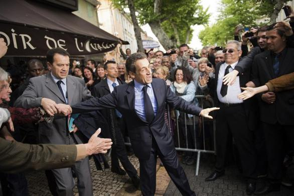 France's President and UMP party candidate for his re-election in the 2012 French presidential elections, Nicolas Sarkozy, shakes hands with supporters during a campaign visit in Chateaurenard, before a campaign rally in Avignon April 30, 2012.