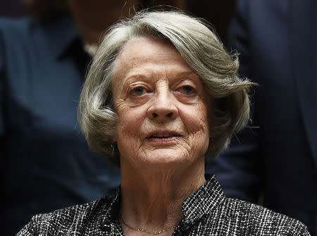 Downton Abbey cast member Maggie Smith poses for the media at a hotel in London