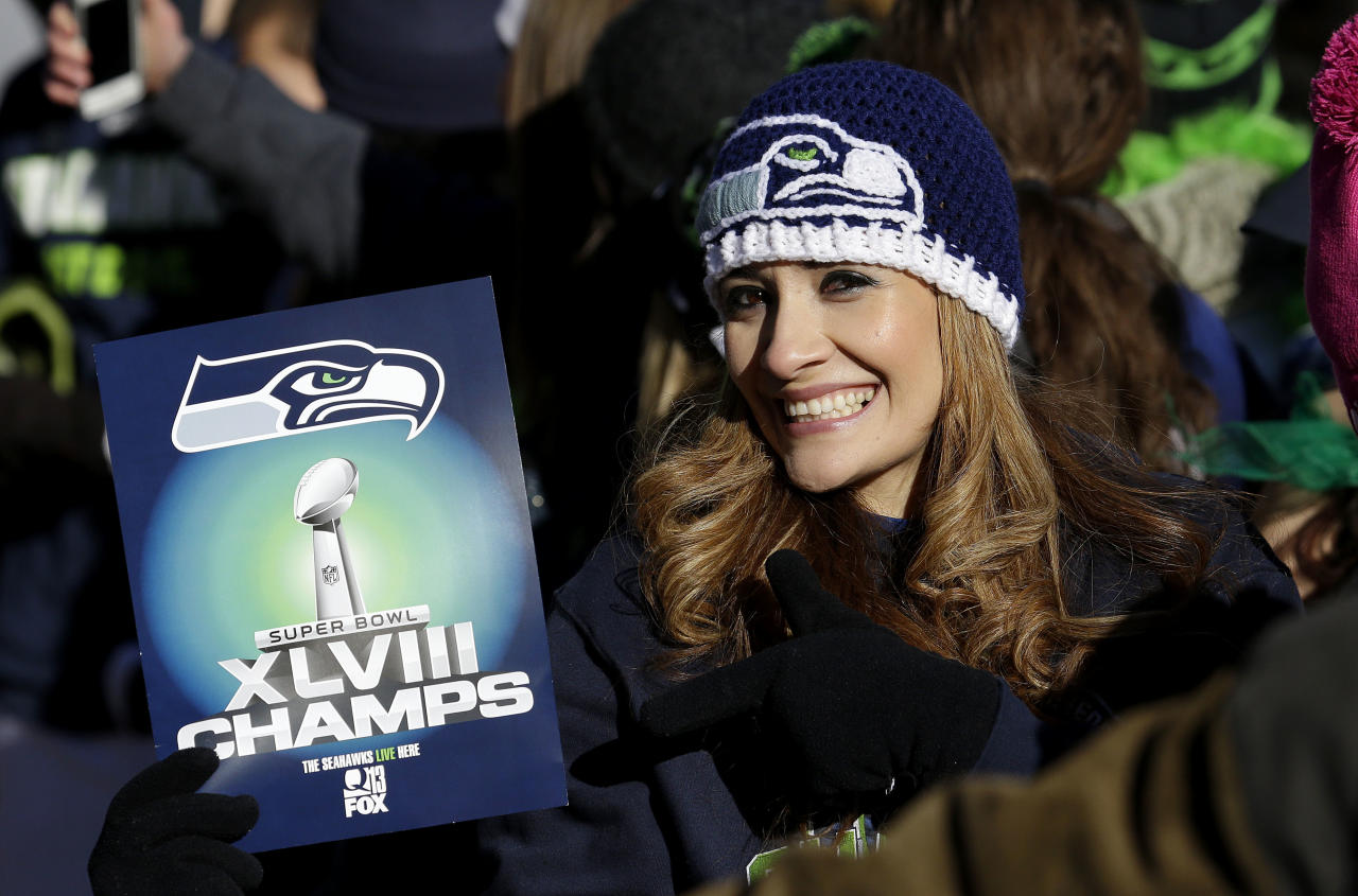 A Seattle Seahawks fan holds up a sign during the Super Bowl champions parade on Wednesday, Feb. 5, 2014, in Seattle. The Seahawks beat the Denver Broncos 43-8 in NFL football's Super Bowl XLVIII on Sunday. (AP Photo/Ted S. Warren)