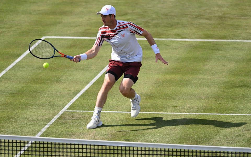 Andy Murray of Great Britain plays a forehand during his First Round match against Benoît Paire of France during Day 2 of the cinch Championships at The Queen's Club on June 15, 2021 in London, England - Getty Images Europe