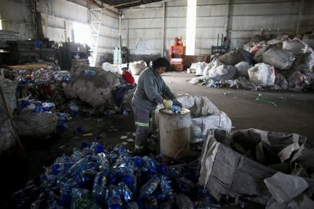 "A waste picker of the ""Bella Flor"" cooperative works in the neighborhood of Jose Leon Suarez, on the outskirts of Buenos Aires"