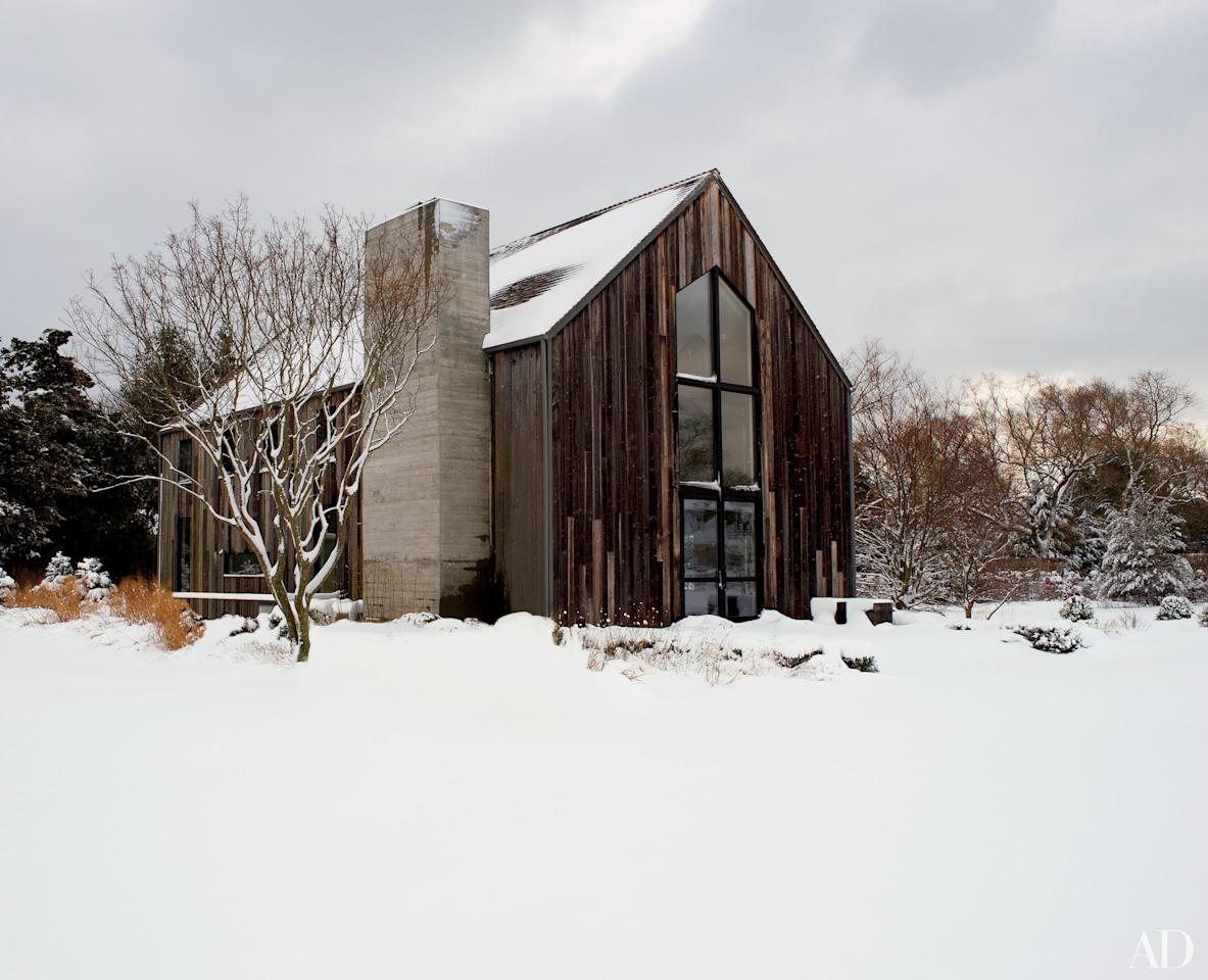 """Vincent Herbert, CEO of Le Pain Quotidien, and his wife, Laurence Verbeke, enlisted Francis D'Haene of D'Apostrophe Design to renovate their 23-year-old barn-inspired home <a rel=""""nofollow"""" href=""""http://www.architecturaldigest.com/story/francis-dhaene-hamptons-home-article?mbid=synd_yahoo_rss"""">weekend house in Remsenburg, New York</a>. Much of its exterior was replaced with siding salvaged from a 200-year-old Canadian barn."""