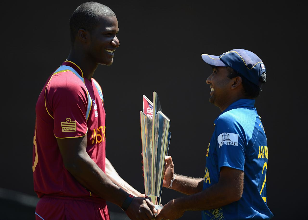 COLOMBO, SRI LANKA - OCTOBER 06:  Darren Sammy, captain of West Indies, Mahela Jayawardene, captain of Sri Lanka pose with the ICC World T20 trophy ahead of the 2012 ICC World Twenty20 Final at R. Premadasa Stadium on October 6, 2012 in Colombo, Sri Lanka.  (Photo by Gareth Copley/Getty Images)