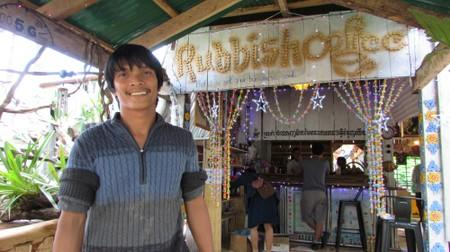 Ouk Vanday, the founder of the Coconut School which teaches English and good waste management, smiles at his Rubbish Cafe coffee shop at the Kirirom National Park in Kampong Speu province, Cambodia