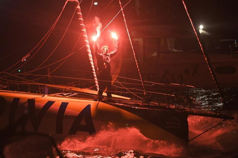 Flare for a finish: French skipper Charlie Dalin sails Apivia across the finish line