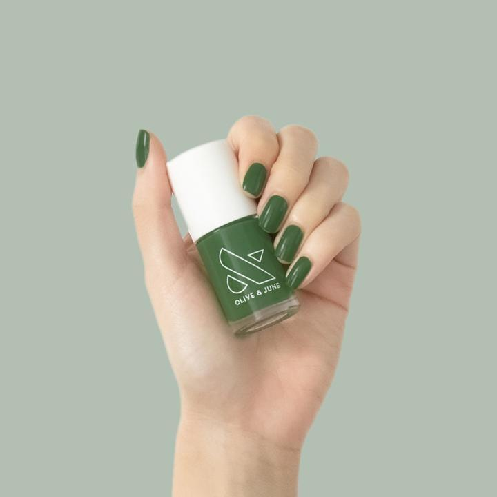 """<h2>Olive & June Geometry Nail Polish</h2><br>""""Olive & June's <a href=""""https://www.refinery29.com/en-us/2021/08/10638268/olive-and-june-fall-nail-collection-2021-review"""" rel=""""nofollow noopener"""" target=""""_blank"""" data-ylk=""""slk:gorge fall collection"""" class=""""link rapid-noclick-resp"""">gorge fall collection</a> just dropped, and there's truly a shade for every nail personality. However, I immediately developed a serious color crush on Geometry, the dreamy hunter green seen here. I may not have been much of a math person growing up, but this hue is definitely speaking my language."""" <em>– Karina Hoshikawa, Beauty & Wellness Market Writer</em><br><br><em>Shop <a href=""""https://oliveandjune.com/"""" rel=""""nofollow noopener"""" target=""""_blank"""" data-ylk=""""slk:Olive & June"""" class=""""link rapid-noclick-resp"""">Olive & June</a></em><br><br><strong>Olive and June</strong> Geometry, $, available at <a href=""""https://go.skimresources.com/?id=30283X879131&url=https%3A%2F%2Foliveandjune.com%2Fproducts%2Fgeometry"""" rel=""""nofollow noopener"""" target=""""_blank"""" data-ylk=""""slk:Olive and June"""" class=""""link rapid-noclick-resp"""">Olive and June</a>"""