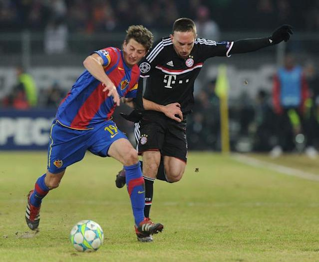 (R-L) Bayern Munich's French midfielder Franck Ribery (R) and Basel's Italian defender David Abraham challenge for the ball during the UEFA Champions League round of sixteen first leg match between Bayern Munich and FC Basel in the St. Jakob stadium in Basel, Switzerland, on February 22, 2012. Basel won the match 1-0. (Photo by Christof Stache/AFP/Getty Images)