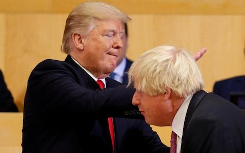 U.S. President Donald Trump pats then Foreign Secretary Boris Johnson on the back as they participate in a session on reforming the United Nations at U.N. Headquarters in New York - Credit: Reuters