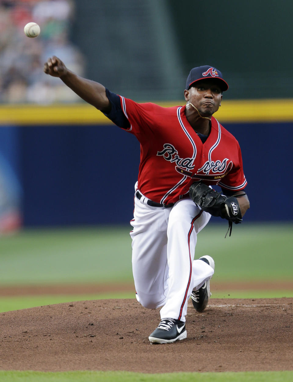 Atlanta Braves starting pitcher Julio Teheran throws in the first inning of a baseball game against the Washington Nationals in Atlanta, Friday, May 31, 2013. (AP Photo/John Bazemore)