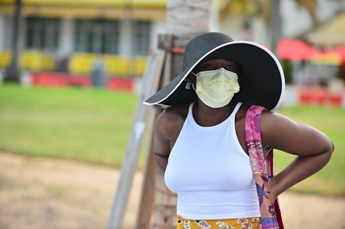 A girl wearing a face mask with outdoor dining space on Ocean Drive in Miami Beach, Florida. (Photo by Johnny Louis/Getty Images)