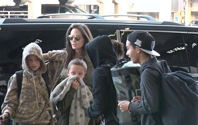 Ange was seen with the kids at the airport leaving before Father's Day. Source: Backgrid