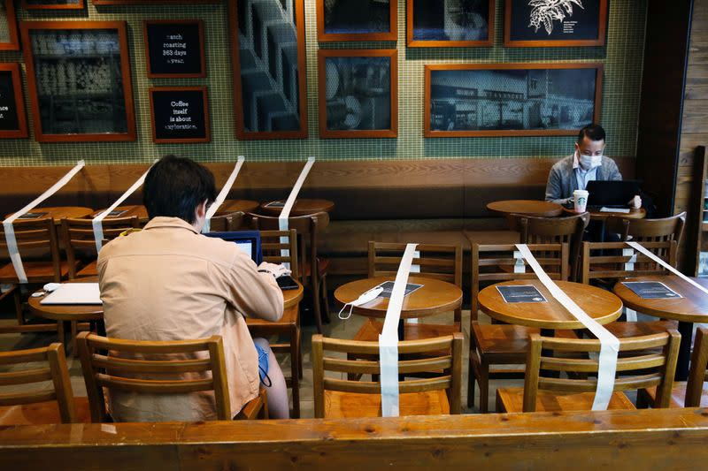 FILE PHOTO: Tables and chairs are taped up to keep social distancing at a Starbucks coffee shop, following the novel coronavirus disease (COVID-19) outbreak, in Hong Kong