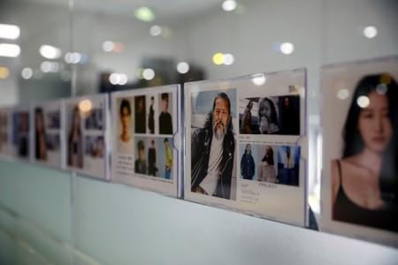 Profile picture of South Korean senior model Kim Chil-doo, 65-years-old, hangs on a glass wall at a model agency in Seoul