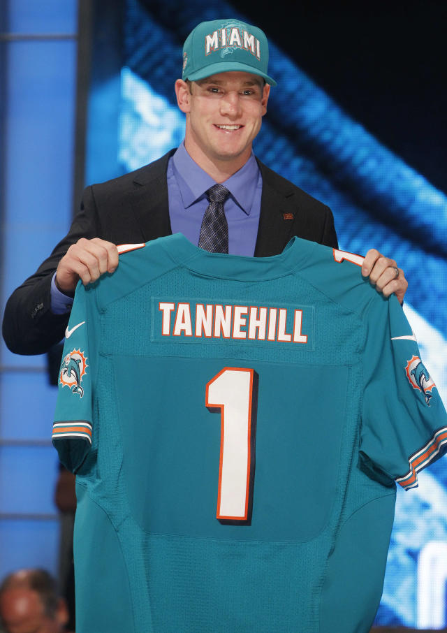 Texas A&M quarterback Ryan Tannehill poses for photographs after being selected as the eighth pick overall by the Miami Dolphins in the first round of the NFL football draft at Radio City Music Hall, Thursday, April 26, 2012, in New York. (AP Photo/Jason DeCrow)