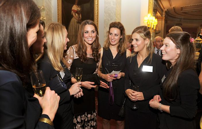 LONDON, UNITED KINGDOM - OCTOBER 23: Catherine, Duchess of Cambridge (C) talks the Women's hockey team during a reception held for Team GB Olympic and Paralympic London 2012 medalists at Buckingham Palace on October 23, 2012 in London, England. (Photo by John Stillwell - WPA Pool/Getty Images)