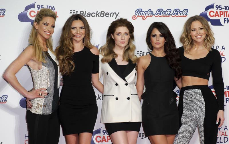 From left, Sarah Harding, Nadine Coyle, Nicola Roberts, Cheryl Cole and Kimberley Walsh, arrive for the Jingle Bell Ball on Sunday, Dec. 9, 2012, in London. (Photo by Jonathan Short/Invision/AP)