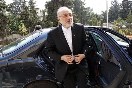 Iranian Foreign Minister Ali Akbar Salehi reacts upon his arrival to attend the official opening ceremony for the new headquarters of the Iranian embassy in Amman