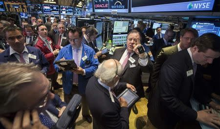Traders work on the floor of the New York Stock Exchange