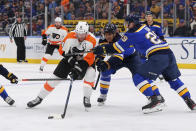 St. Louis Blues center Brayden Schenn (10) and defenseman Vince Dunn (29) defend against Philadelphia Flyers center Sean Couturier (14) during the first period of an NHL hockey game Wednesday, Jan. 15, 2020 in St. Louis. (AP Photo/Dilip Vishwanat)