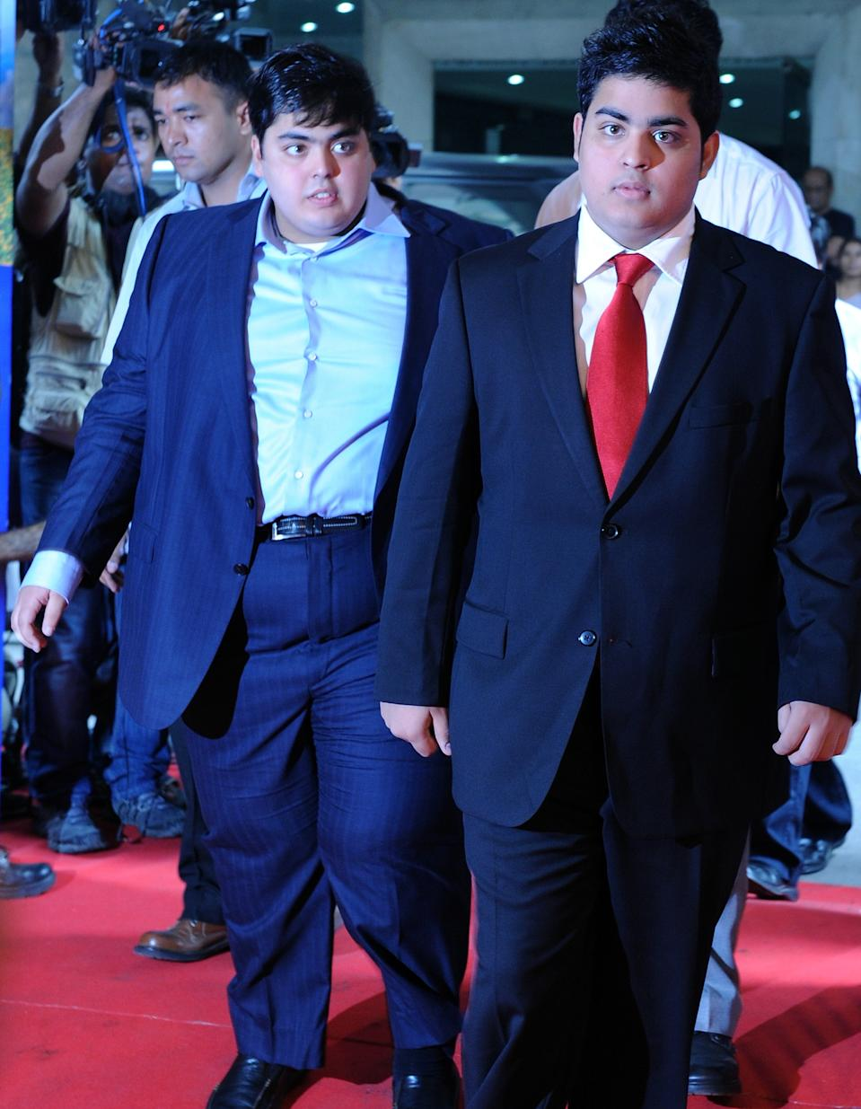 "The sons of Reliance Industries Chairman Mukesh Ambani, Anant (L) and Akash (R) arrive for the company's annual general meeting in Mumbai on June 3, 2011. India's largest private firm Reliance Industries plans to become completely debt-free in the financial year, its chairman Mukesh Ambani announced. Ambani, India's richest man, said Reliance planned to ""significantly enhance its ranking amongst global businesses"" as economic growth expands in India, with an aim to ramp-up its existing oil and gas and retail businesses further. AFP PHOTO/ Indranil MUKHERJEE (Photo credit should read INDRANIL MUKHERJEE/AFP/Getty Images)"