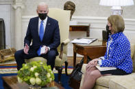 FILE - In this May 13, 2021, file photo, Sen. Shelley Moore Capito, R-W.Va., right, listens as President Joe Biden speaks during a meeting with Republican Senators in the Oval Office of the White House in Washington. The two senators from West Virginia are playing central roles in Biden's infrastructure plans. Democrat Joe Manchin is a crucial 50th vote for his party on Biden's proposals. (AP Photo/Evan Vucci)