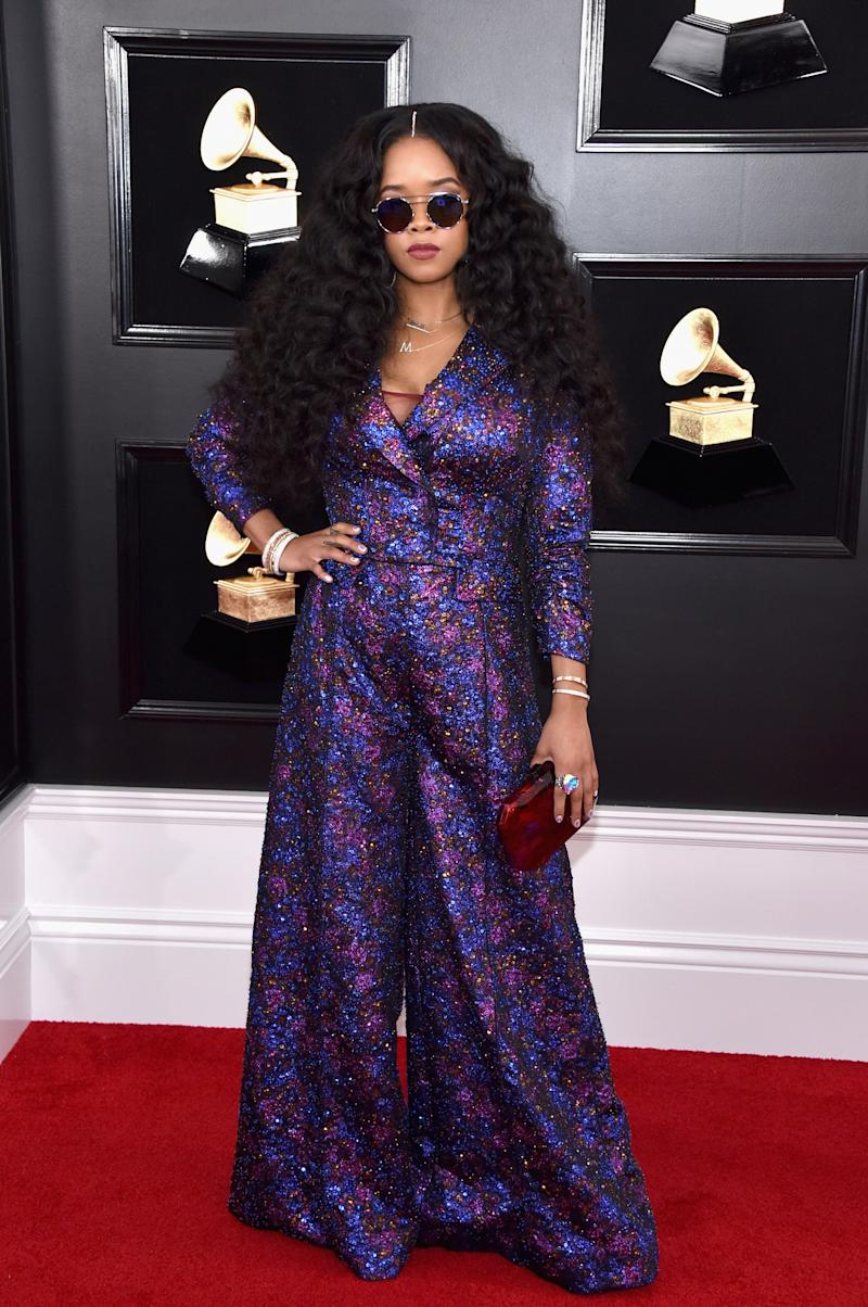 H.E.R. in Coach and Judith Leiber Couture bag