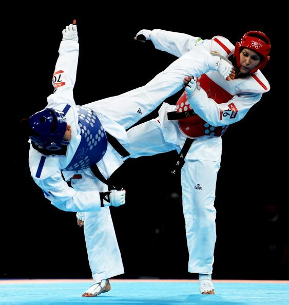 LONDON, ENGLAND - AUGUST 11:  Anne-Caroline Graffe of France (blue) competes against Natalya Mamatova of Uzbekistan (red) during the Women's  67kg Taekwondo Preliminary Roundon on Day 15 of the London 2012 Olympic Games at ExCeL on August 11, 2012 in London, England.  (Photo by Lars Baron/Getty Images)