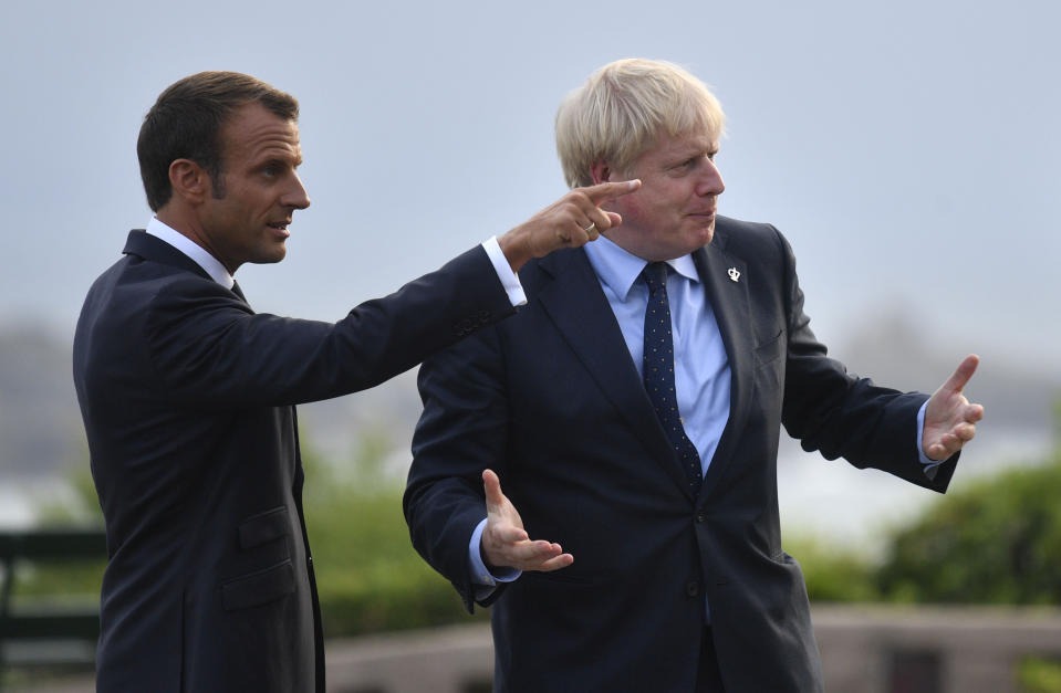 French President Emmanuel Macron speaks with prime Minister Boris Johnson (right) at the official welcome during the G7 summit in Biarritz, France.