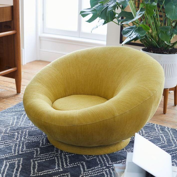 <p>We want to lounge around in this <span>West Elm Groovy Swivel Chair</span> ($399).</p>