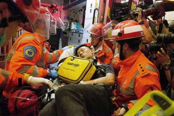 PHOTO: A man who protesters reportedly suspected of being an undercover Chinese policeman is taken away by medics at Hong Kong International Airport, Aug. 13, 2019. (Rick Findler/REX via Shutterstock)