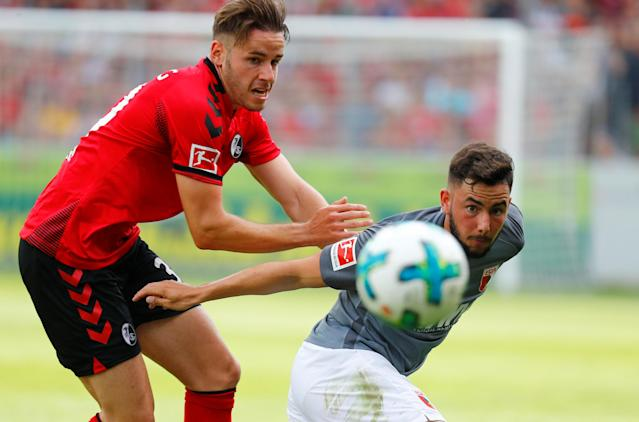 Soccer Football - Bundesliga - SC Freiburg v FC Augsburg - Schwarzwald-Stadion, Freiburg, Germany - May 12, 2018 SC Freiburg's Christian Gunter in action with Augsburg's Marco Richter REUTERS/Kai Pfaffenbach DFL RULES TO LIMIT THE ONLINE USAGE DURING MATCH TIME TO 15 PICTURES PER GAME. IMAGE SEQUENCES TO SIMULATE VIDEO IS NOT ALLOWED AT ANY TIME. FOR FURTHER QUERIES PLEASE CONTACT DFL DIRECTLY AT + 49 69 650050